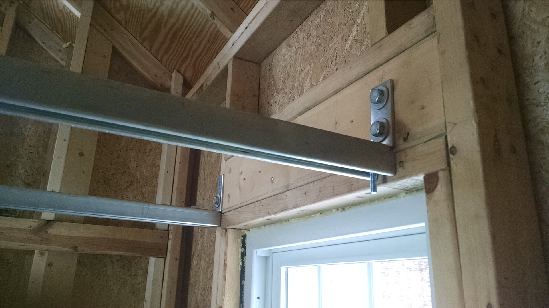 c-channel used as joists; and lag bolted to a reinforced window header