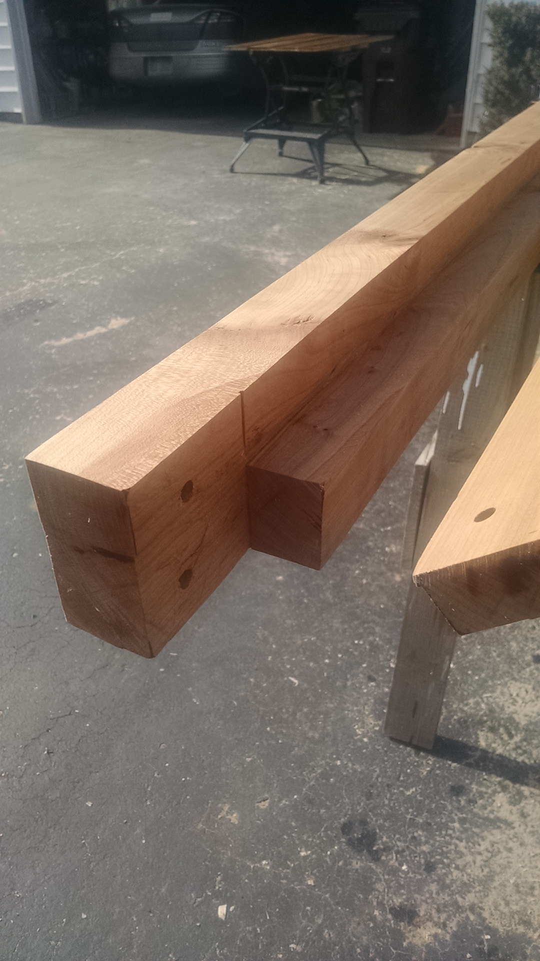 the loft beams were cut to provide a ledge for the floor planks and to ease attachment (bolting) to the studs