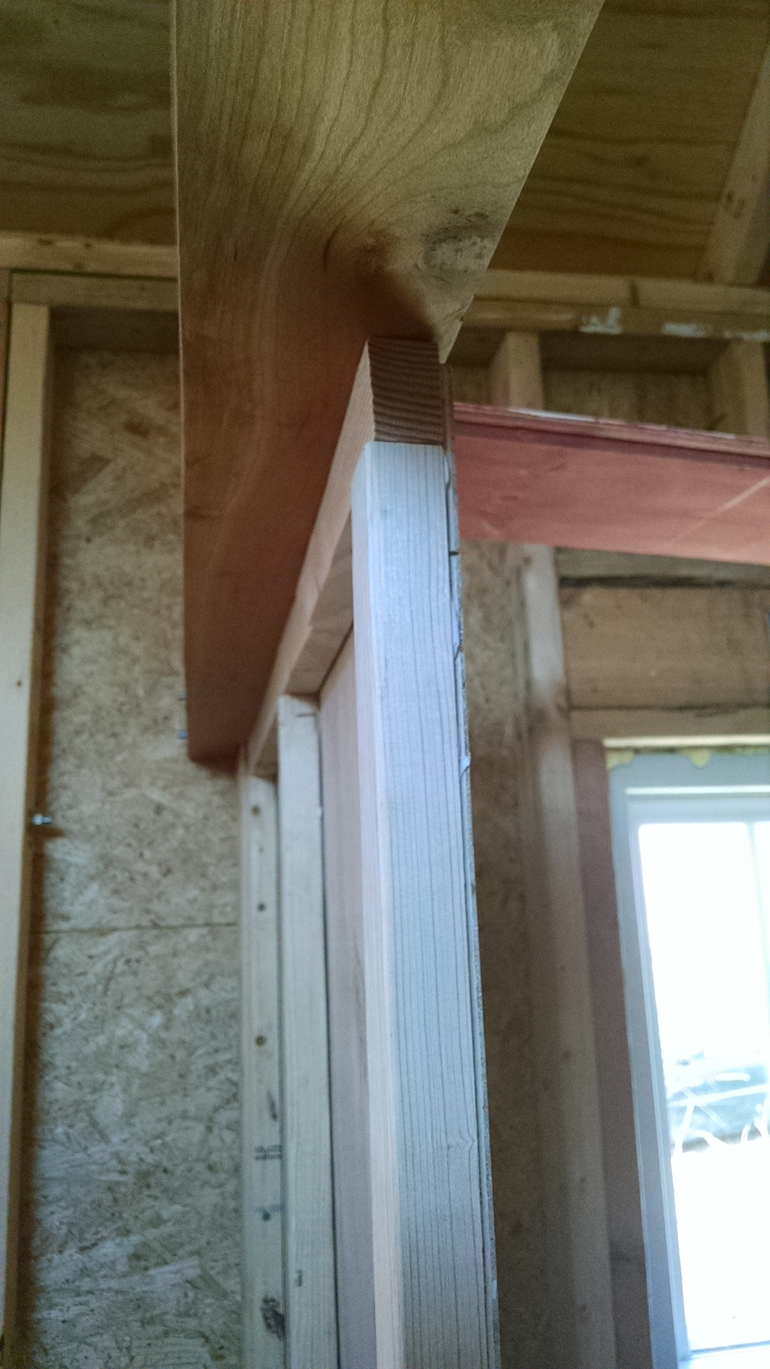the thin bathroom wall, showing how it's offset under the beam to make room for a sliding door