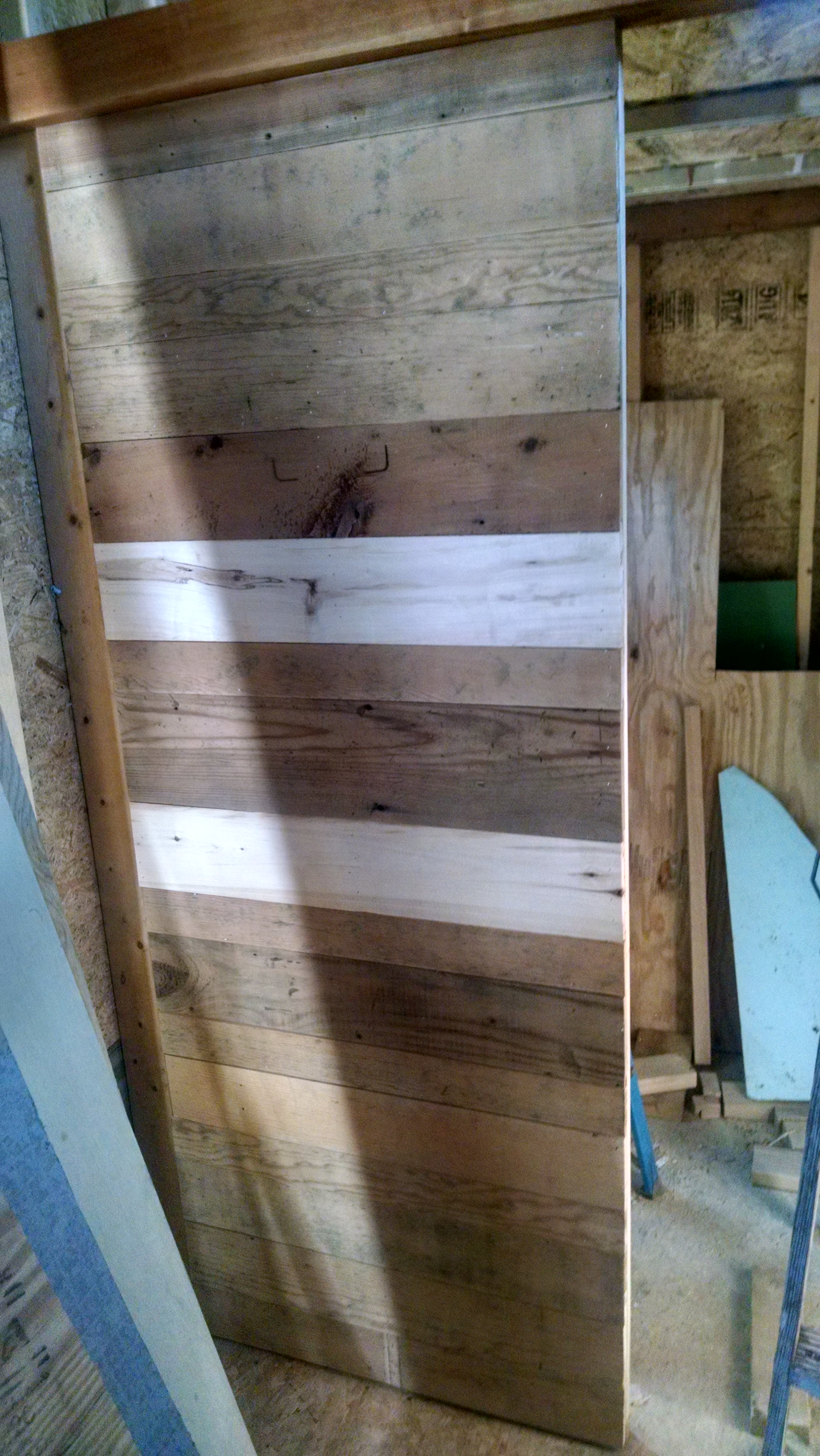 reclaimed wood used as the skin on the bathroom wall; I treated with boiled linseed oil after this picture was taken to pretty it up a little bit
